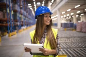 warehouse-inventory-manager-holding-checklist-and-looking-aside (FILEminimizer)